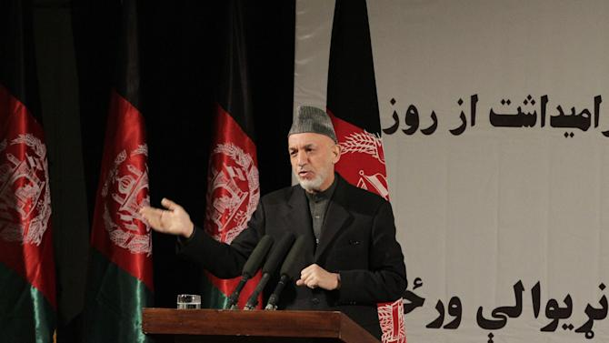 Afghan President Hamid Karzai speaks during a nationally televised speech about the state of Afghan women in Kabul, Afghanistan, Sunday, March, 10, 2013. Karzai on Sunday accused the Taliban and the U.S. of working in concert to convince Afghans that violence will worsen if most foreign troops leave as planned by the end of next year. Karzai says two deadly suicide bombings on Saturday show the insurgent group is conducting attacks to help show that international forces will still be needed to keep the peace after their current combat mission ends in 2014. (AP Photo/Ahmad Jamshid)