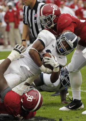Georgia Southern fullback Dominique Swope (31) is stopped by Alabama defensive lineman Quinton Dial (90) and linebacker Dont'a Hightower (30) in the first half of an NCAA college football game at Bryant-Denny Stadium in Tuscaloosa, Ala., Saturday, Nov. 19, 2011. (AP Photo/Dave Martin)