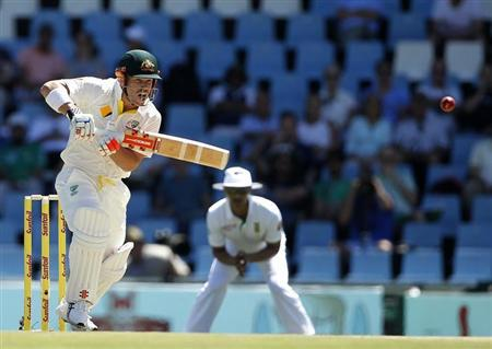 Australia's David Warner plays a shot during the first day of their cricket test match against South Africa in Centurion February 12, 2014. REUTERS/Siphiwe Sibeko/Files
