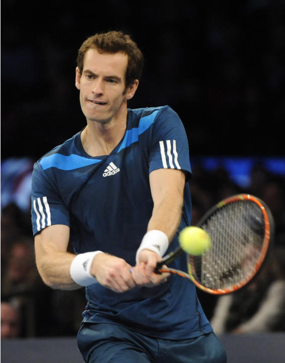 Andy Murray returns a shot against Novak Djokovic in the BNP Paribas Showdown Tennis Tournament on Monday, March 3, 2014, in New York. (AP Photo/Kathy Kmonicek)