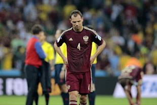 Russia's Sergei Ignashevich reacts as he leaves the pitch following a draw to Algeria. (AP)
