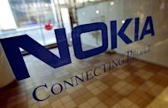 Nokia cut its first quarter operating margin outlook as fierce competition hurt its mobile phone sales, sending the company's share price plunging more than 14 percent