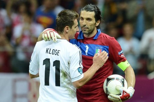 Italian goalkeeper Gianluigi Buffon and German forward Miroslav Klose hug after the match
