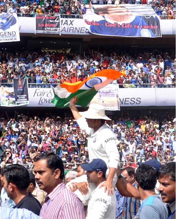 Indian cricketers Shikhar Dhawan and Murli Vijay lift master blaster Sachin Tendulkar on their shoulder as the legend bid adieu to international cricket at Wankhede stadium in Mumbai on Nov.16, 2013.