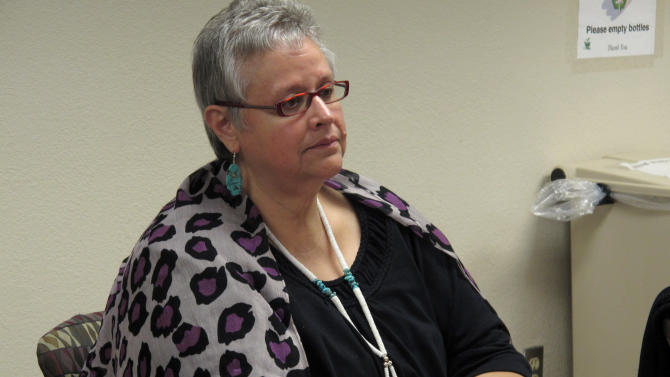 In this Oct. 19, 2012 photo, Charon Asetoyer, executive director of the Native American Community Board, is shown at an Albuquerque fourm on access for American Indian women getting emergency contraceptive Plan B. The federal Indian Health Services has said it is finalizing a policy to make Plan B available to American Indian women at its facilities much like it is in retail pharmacies across the country — without requiring a consultation with a health care provider and without a prescription, except for those under 17.  (AP Photo/Russell Contreras)