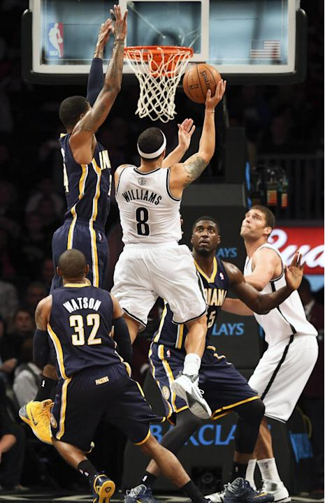 Brooklyn Nets point guard Deron Williams (8) jumps for a layup during the first quarter of an NBA basketball game, Saturday, Nov. 9, 2013, at the Barclays Center in New York