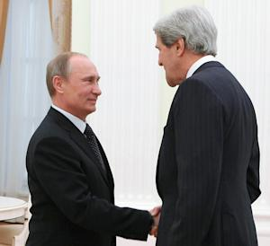 Russian President Vladimir Putin, left, and U.S. Secretary of State John Kerry shake hands during their meeting in the Kremlin in Moscow, Tuesday, May 7, 2013. John Kerry is making his case to Russian President Vladimir Putin for Russia to take a tougher stance on Syria at a time when Israel's weekend air strikes against the beleaguered Mideast nation have added an unpredictable factor to the talks. (AP Photo/RIA-Novosti, Mikhail Klimentyev, Presidential Press Service)