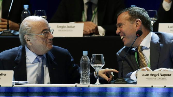 FIFA President Sepp Blatter speaks with CONMEBOL President Juan Angel Napout at the CONMEBOL ordinary congress in Luque