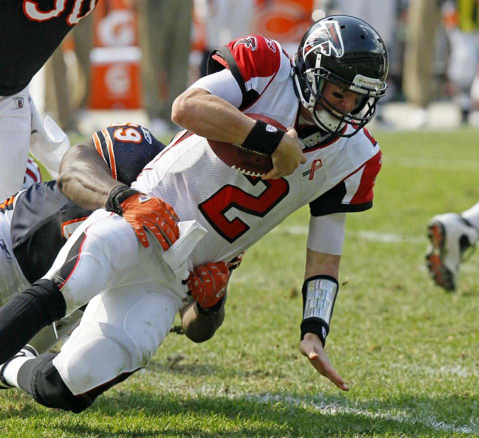 Atlanta Falcons quarterback Matt Ryan (2) is sacked by Chicago Bears defensive lineman Henry Melton in the second half of an NFL football game in Chicago, Sunday, Sept. 11, 2011. The Bears won 30-12. (AP Photo/Charles Rex Arbogast)