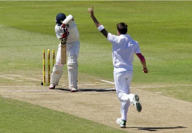 South Africa's Steyn celebrates bowling India's Pujara during the fifth day of the second cricket test match in Durban