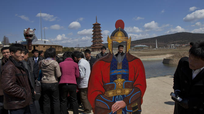 North Koreans visit the Pyongyang Folk Park on the outskirts of Pyongyang Thursday, April 11, 2013. The park, which spans Korean history from prehistoric to modern times, opened in September 2012 after three years of construction by North Korean soldiers.  (AP Photo/David Guttenfelder)
