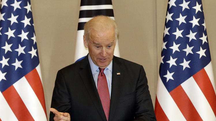 U.S. Vice President Joe Biden gestures before the meeting with South Korean President Park Geun-hye at the presidential Blue House in Seoul, South Korea, Friday, Dec. 6, 2013. (AP Photo/Lee Jin-man)