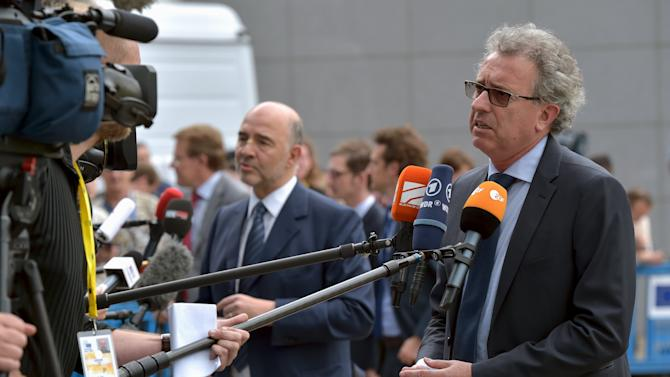 Luxembourg's Finance Minister Gramegna and European Commissioner for Economic and Financial Affairs, Taxation and Customs Moscovici talk to the media as they arrive at a euro zone finance ministers meeting on the situation in Greece in Brussels, Belgium