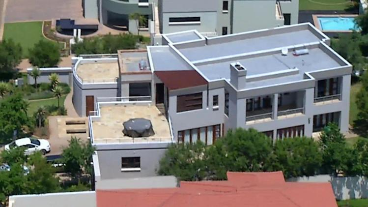 File - This file aerial image taken from video provided by VNS24/7 on Thursday, Feb. 14, 2013, shows the home of Olympic athlete Oscar Pistorius in a gated housing complex in Pretoria, South Africa. Oscar Pistorius is selling the house where Reeva Steenkamp was kiiled to raise money for his legal bills, and has still never returned to the upscale villa since the day he shot his girlfriend in an upstairs bathroom over a year ago, the athlete's lawyer said Thursday. (AP Photo/VNS24/7-File)