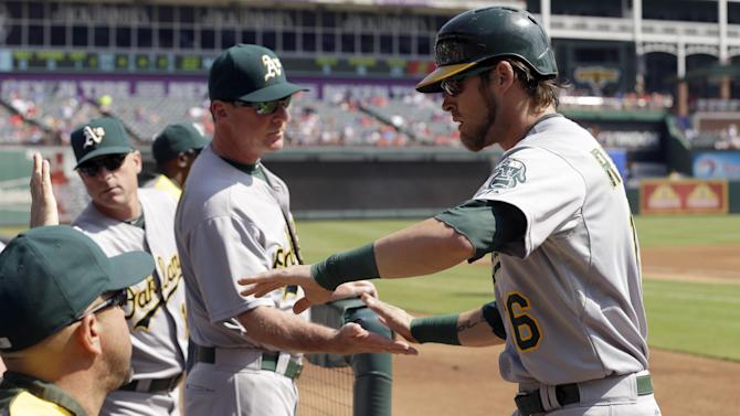 A's clinch AL wild card with 4-0 win at Texas