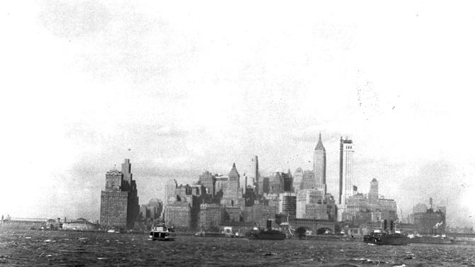 FILE - This Nov. 7, 1930, file photo, shows New York's skyline from the harbor.  The Governor's Island Ferry is at right. On Monday, April 30, 2012, One World Trade Center _ being built to replace the twin towers destroyed on 9/11 _  will get steel columns to make its unfinished framework a little higher than the Empire State Building's observation deck, to become the tallest building in New York. (AP Photo/File)