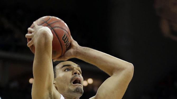 Kansas forward Perry Ellis puts up a shot during the second half an NCAA college basketball game against Iowa State in the Big 12 men's tournament Friday, March 15, 2013, in Kansas City, Mo. Kansas won the game 88-73. (AP Photo/Charlie Riedel)
