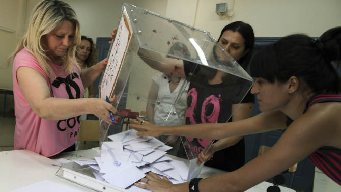 Election officials empty a ballot box to count votes during a parliamentary election at a polling station, in Athens, Sunday, June 17, 2012. Greeks are voting Sunday for the second time in six weeks in what is arguably their country's most critical election in 40 years. (AP Photo/Petros Giannakouris)