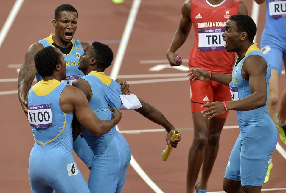 Bahamas' men's 4x400-meter relay team Chris Brown, Demetrius Pinder, Michael Mathieu, and Ramon Miller celebrate their victory during the athletics in the Olympic Stadium at the 2012 Summer Olympics, London, Friday, Aug. 10, 2012. (AP Photo/Martin Meissner)