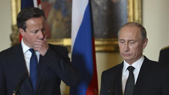 British Prime Minister David Cameron, left, stands with Russian President Vladimir Putin during a press conference at 10 Downing Street in London, Sunday June 16, 2013. Cameron had talks with Russian President Putin on the Syrian crisis amid fears that differences between Moscow and the West are pushing the two sides towards a new Cold War. (AP Photo/Anthony Devlin)