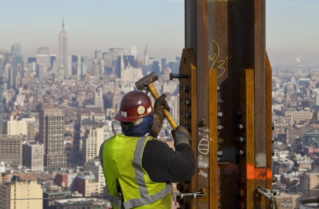 "<p>               FILE- In this Dec. 16, 2010, file photo, an ironworker connects a steel plate to a column at One World Trade Center in New York. The Empire State Building is visible in the rear upper left. One World Trade Center, the giant monolith being built to replace the twin towers destroyed in the Sept. 11 attacks, will lay claim to the title of New York City's tallest skyscraper on Monday, April 30, 2012, as workers erect steel columns that will make its unfinished skeleton a little over 1,250 feet, just high enough to peak over the observation deck on the Empire State Building. The milestone is a preliminary one. The so-called ""Freedom Tower"" isn't expected to reach its full height for at least another year, at which point it is likely to be declared the tallest building in the U.S.  (AP Photo/Mark Lennihan, File)"