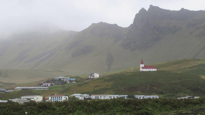 Vik, a small Icelandic town of just 300 people, where residents still recall stories from their relatives of Katla volcano's last eruption in 1918, sits under a blanket of cloud in this Sept. 27, 2011 photo. If Iceland's air-traffic paralyzing volcanic eruption in 2011 seemed catastrophic, just wait for the sequel. That's what many experts are saying as they nervously watch rumblings beneath a much more powerful Icelandic volcano - Katla - which could spew an ash cloud dwarfing eruption that cost airlines $2 billion and drove home how vulnerable modern society is to the whims of nature.(AP Photo/Paisley Dodds)