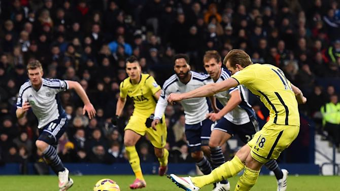 Tottenham Hotspur's English striker Harry Kane (R) scores from the penalty spot during the English Premier League football match between West Bromwich Albion and Tottenham Hotspur in West Bromwich, England, on January 31, 2015