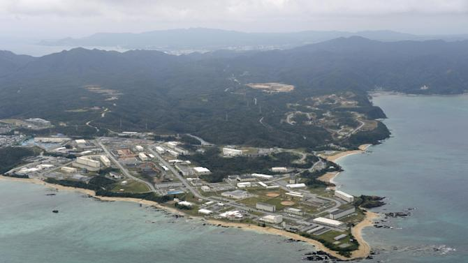 This Thursday, Dec. 26, 2013 photo, shows Henoko of Nago city on southern Japanese islands of Okinawa. Okinawan Gov. Hirokazu Nakaima signed off Friday, Dec. 27, 2013, on the long-awaited relocation of a U.S. military base, a major step toward allowing the U.S. to move forward with plans to consolidate its troops in Okinawa and move some to Guam. Nakaima approved the Japanese government's application to reclaim land for a new base in Henoko, which would replace the U.S. Marine Corps base in Futenma, a more congested part of Okinawa's main island, Japanese media reported. (AP Photo/Kyodo News) JAPAN OUT, CREDIT MANDATORY