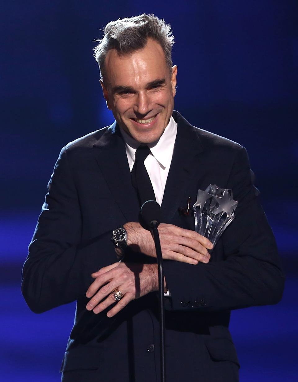 "Daniel Day-Lewis accepts the award for best actor for ""Lincoln"" at the 18th Annual Critics' Choice Movie Awards at the Barker Hangar on Thursday, Jan. 10, 2013, in Santa Monica, Calif.  (Photo by Matt Sayles/Invision/AP)"