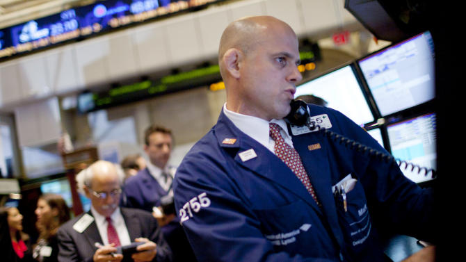 Traders work on the floor of the New York Stock Exchange on Wednesday, August 3, 2011, in New York. (AP Photo/Jin Lee)