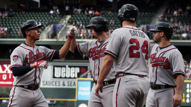 Braves hit 3 home runs in 13-10 win over Rockies
