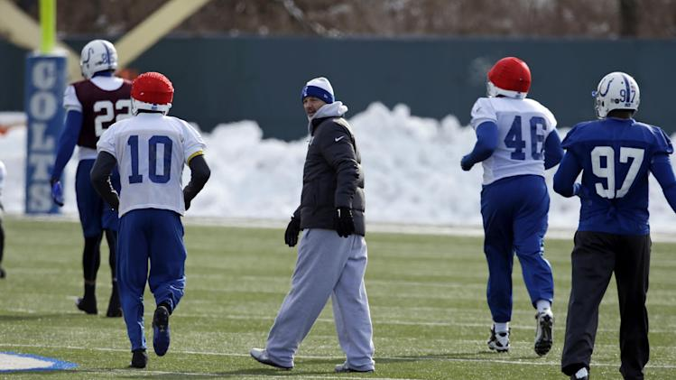 Indianapolis Colts head coach Chuck Pagano, center,  watches practice at the Colts complex Wednesday, Jan. 2, 2013, in Indianapolis. The Colts will play the Baltimore Ravens in an AFC Wild Card playoff game Sunday. (AP Photo/Darron Cummings)