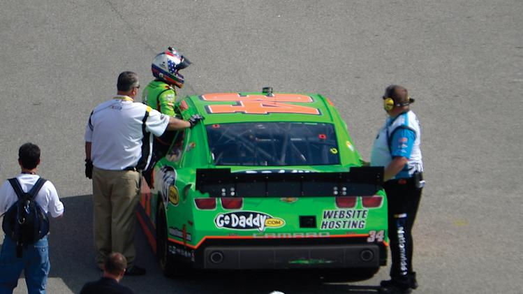 Danica Patrick gets out of her car near the garage area during a Nationwide Series auto race at Daytona International Speedway in Daytona Beach, Fla., Saturday, Feb. 23, 2013.(AP Photo/Phelan M. Ebenhack)