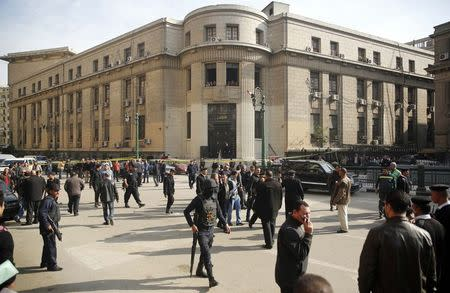Bomb near top Cairo court house kills two; other blasts hit capital