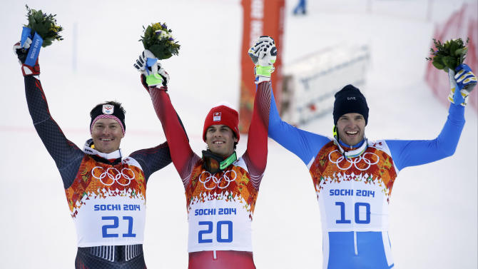 Men's supercombined medalists from left, Croatia's Ivica Kostelic (silver), Switzerland's Sandro Viletta (gold) and Italy's Christof Innerhofer (bronze) pose for photographers on the podium during a flower ceremony at the Alpine ski venue at the Sochi 2014 Winter Olympics, Friday, Feb. 14, 2014, in Krasnaya Polyana, Russia.(AP Photo/Christophe Ena)