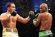 Oct 26, 2013; Atlantic City, NJ, USA; Bernard Hopkins (black/green trunks) and Karo Murat (white/gold trunks) box during their IBF Light Heavyweight title bout at Boardwalk Hall. Hopkins won via unanimous decision. Mandatory Credit: Joe Camporeale-USA TODAY Sports