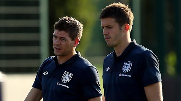 England's Steven Gerrard (left) and Michael Carrick look on during the training session at London Colney (PA Photos)