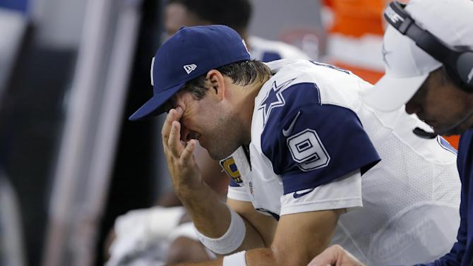 Dallas Cowboys quarterback Tony Romo sits on the bench after throwing his third interception of the first half of an NFL football game against the Carolina Panthers, Thursday, Nov. 26, 2015, in Arlington, Texas. (AP Photo/Brandon Wade)