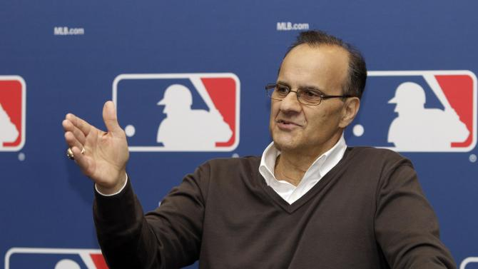 FILE - In this Feb. 26, 2011 file photo,  Joe Torre, Major League Baseball's executive vice president for baseball operations,  gestures during a news conference in Scottsdale,  Ariz. Torre has resigned as Major League Baseball's executive vice president for baseball operations to join a group trying to buy the Los Angeles Dodgers.  (AP Photo/Marcio Jose Sanchez, File)