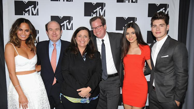 "From left, Chrissy Teigen of MTV's ""Snack Off"", CEO of Viacom Philippe Dauman, President of Programming for MTV Susanne Daniels, COO of Viacom Tom Dooley, Victoria Justice of MTV's ""Eye Candy"" and Gregg Sulkin of MTV's ""Faking It"" during the 2014 MTV Upfront Presentation, on Thursday, April 24, 2014 at the Beacon Theatre in New York. (Photo by Scott Gries/Invision for MTV/AP Images)"