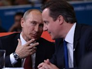 Russia&#39;s President Vladimir Putin (L) and British Prime Minister David Cameron (R) watch the judo at the London Olympics. Russian President Vladimir Putin and British premier David Cameron failed to hide their differences on the Syrian crisis on Thursday before the two leaders watched the Olympic judo together