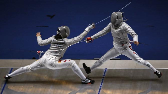 South Korea's Lee competes against China's Li during the semi-final of  their sabre bout in the women's individual competition of the 17th Asian Games in Incheon
