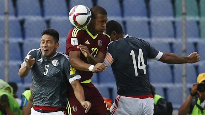 Venezuela's Rondon heads the ball next to Paraguay's Da Silva and Valdez during their 2018 World Cup qualifying soccer match at Cachamay stadium in Puerto Ordaz