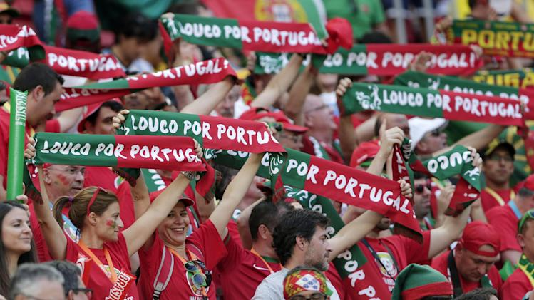 Portugal's fans cheer before the group G World Cup soccer match between Portugal and Ghana at the Estadio Nacional in Brasilia, Brazil, Thursday, June 26, 2014. (AP Photo/Marcio Jose Sanchez)