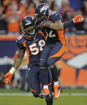 Denver Broncos outside linebacker Wesley Woodyard (52) celebrates with outside linebacker Von Miller (58) after recovering a fumble by San Diego Chargers quarterback Philip Rivers (17) in the third quarter of an NFL football game, Sunday, Nov. 18, 2012, in Denver. (AP Photo/Jack Dempsey)