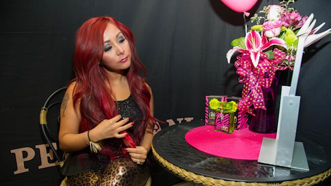 "Nicole ""Snooki"" Polizzi prepares herself for a meet and greet at a Perfumania for the release of her second fragrance, ""Snooki Couture"" on Wednesday, January 9, 2013, in Las Vegas, NV (Photo by Al Powers/Powers Imagery/Invision/AP)"