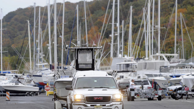 "As Hurricane Sandy moves up the East Coast, owners remove their boats from the water at the Atlantic Highlands Marina, Friday Oct. 26, 2012 in Atlantic Highlands, N.J. When Hurricane Sandy becomes a hybrid weather monster some call ""Frankenstorm"" it will smack the East Coast harder and wider than last year's damaging Irene, forecasters said Friday. (AP Photo/Joe Epstein)"