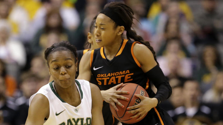 Baylor' Brooklyn Pope (32) and Oklahoma State guard Tiffany Bias (3) collide while chasing a loose ball in the first half of an NCAA college basketball game in the Big 12 women's tournament on Sunday, March 10, 2013, in Dallas. (AP Photo/Tony Gutierrez)
