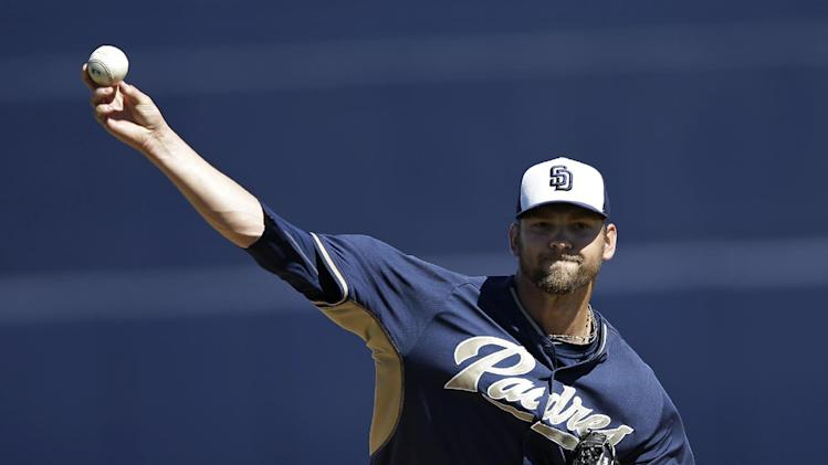 San Diego Padres starting pitcher Josh Johnson throws before an exhibition spring training baseball game against the Cleveland Indians Saturday, March 8, 2014, in Peoria, Ariz