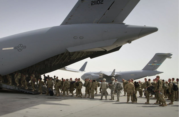 FILE - In this July 14, 2011, file photo, U.S. soldiers board a U.S. military plane, as they leave Afghanistan, at the U.S. base in Bagram north of Kabul, Afghanistan. The Obama administration gave the first explicit signal Tuesday, Jan. 8, 2013, that it might leave no troops in Afghanistan after December 2014, an option that defies the Pentagon&#39;s view that thousands of troops may be needed to keep a lid on al-Qaida and to strengthen Afghan forces.(AP Photo/Musadeq Sadeq, File)
